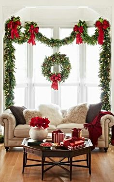 Christmas bay window with lighted Christmas garland & red bows - idea for Breakfast nook bay window