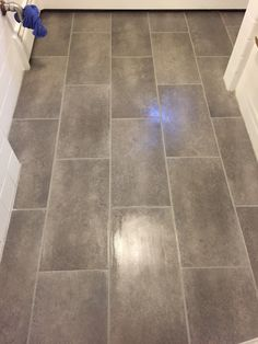 i love my new bathroom floor. it's peel and stick groutable vinyl
