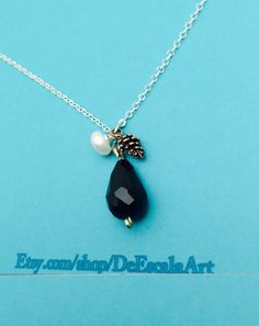 A personal favorite from my Etsy shop https://www.etsy.com/listing/221341481/tear-drop-pendant-necklace-silver-tone