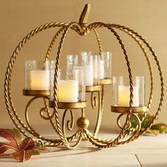 This is no garden-variety centerpiece—it's a Pier 1 exclusive twist on a fall… Pillar Candle Holders, Candle Sconces, Pillar Candles, Votive Holder, Flameless Candles, Pumpkin Centerpieces, Centerpiece Decorations, Wedding Centerpieces, Xmas Lights
