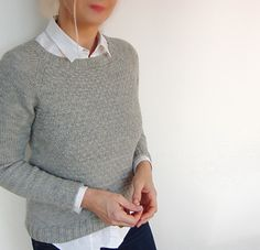 HashMarks is a trendy sweater with an easy to knit slip stitch pattern in the front and a longer bottom shaping.