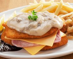 Schnitzels and seafood dishes are served with Spur-style crispy onion rings and chips OR baked potato. Restaurant Specials, Chicken Breast Fillet, Creamy Mushroom Sauce, Crispy Onions, Ham And Cheese, Seafood Dishes, Healthy Alternatives, Baked Potato, Sandwiches