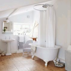 Floor boards and beautiful stand alone bath