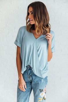 DETAILS: - Short sleeve knit top with overlap detail - Fabric Content: 95% RAYON, 5% SPANDEX - Model is wearing a small
