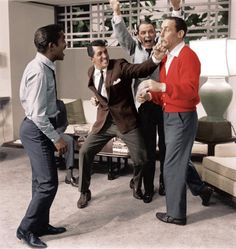 "Frank Sinatra Dean Martin Sammy Davis Jr & Joey Bishop of ""Oceans 11"" stage a fight by Sid Avery"