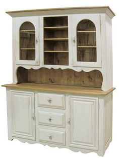 FARM FRESH: This French China Cupboard by KateMadison.com adds a bit of provencal to your kitchen or dining area. The upper domed glass cabinets and center open storage offers lots of room for showing off your dishes and collections. The lower closed storage can house you silver, vases and candlesticks. It's the perfect French Country piece for serving and passing.