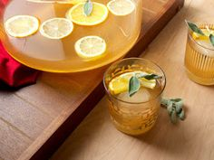 There's no reason to relegate gin to summer; its swath of herbal flavors are wonderful in fall, too. For this make-ahead punch, gin is matched with fresh sage, smoky lapsang souchong tea, and an intense citrus syrup made with lemon and orange zest. Party Drinks, Cocktail Drinks, Cocktail Recipes, Tea Drinks, Milk Shakes, Punch Recipes, Tea Recipes, Party Recipes, Lapsang Souchong Tea