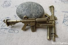 You'll receive 10 pcs of antique bronze M16 machine gun pendants. Double sided.  Very nice looking heavy weight.  Size: 23x63mm  All our items are NICKEL FREE and LEAD FREE... #accessories #antique_bronze_charm #bronze_gun_pendant #bronze_pendant #charm #charms #jewelry_findings #jewelry_supplies #machine_gun #metal_gun #pistol_pendant #supplies #verycharms #weapon_charms
