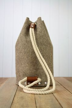 Felt backpack bag which is handmade from 3 mm industrial wool felt and assembled using pop rivets. The strap is made from hand spliced and whipped cotton Sacs Design, Bags Travel, Minimalist Bag, Men's Backpack, Branded Bags, Backpacker, Duffel Bag, Hurley, Bucket Bag