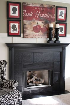 Black fireplace surround and mantel. Eclectic family room by The Yellow Cape Cod