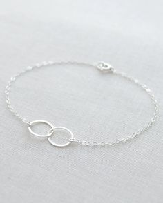 Connected links minimal bracelet by Olive Yew. Silver double circle bracelet is so simple and beautiful. The perfect gift for someone you love. Also available in gold.