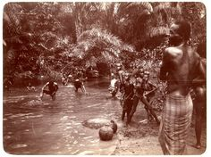 Photograph (black and white) from an album; group of people bathing in a stream, Ukpum-Uwana, Nigeria, 29th January 1905.  Gelatin silver print