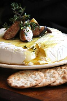 Grilled Brie with Figs  Thyme Honey. I made this for a party and it was absolutely delicious. It was easy to make and a huge hit. We ate it on toasted Italian bread slices. ~Janae