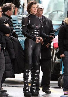 Milla Jovovich has sci-fi sex appeal as she pours herself into a skin tight leather catsuit on Resident Evil 5 set - Milla Jovovich - Zimbio Milla Jovovich Fifth Element, Kate Beckinsale Hot, Resident Evil 5, Leather Catsuit, Comedy Films, Hollywood, Skin Tight, Female Characters, Portrait
