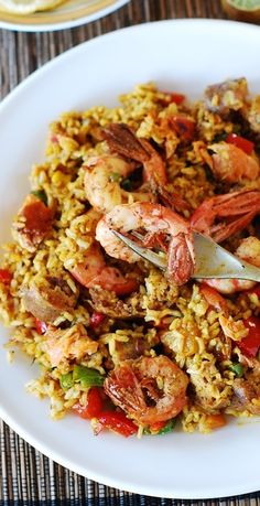 Easy paella with chicken, shrimp and sausage. Spiced up with sweet smoked paprika, chili powder, and just a bit of turmeric for color! You can use orzo pasta or rice. | JuliasAlbum.com | jambalaya, New Orleans, Spanish recipes