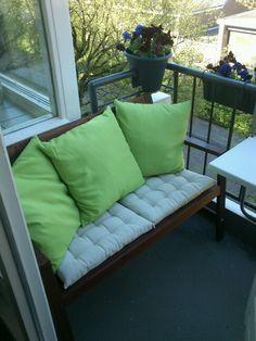 Ikea Applaro bench with pillows on balcony