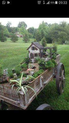 lindo jardim numa carroça