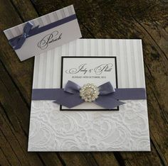 Pretty ribbon brooch detail invitation