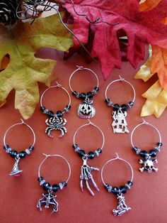 Halloween Wine Glass Charms. Perfect for your Halloween party. Find these and many more at my eBay store Oh Sew Cute Aprons and More. Didn't see what you're looking for? eBay message me and I can create just about anything you are looking for! #ohsewcute #Handmade