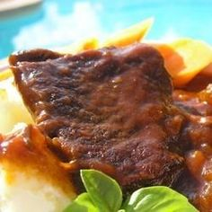 Beef short ribs are a highly flavorful cut. This method of cooking makes the meat so tender you won't need a knife.  The thick rich sauce is delicious served with mashed potatoes and the carrots that cook with the ribs.