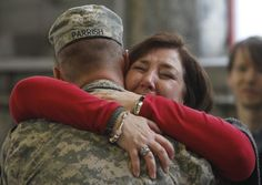 Homecomings are the best! This reminds me of me because I always wear red :)  Brenda Evans embraces Spc. Trey Parrish after the 230th Sustainment Brigade returned to Chattanooga. The unit was deployed to Kuwait for nearly a year to assist in the withdrawal of U.S. troops from Iraq.