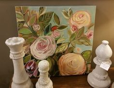 Vintage floral painting and white chess pieces. www.interiorsonmain.com