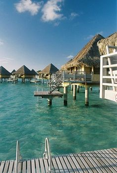 What are overwater bungalows? Where around the world can I stay in one? Advice on travel planning from the travel experts at Visual Itineraries. Bora Bora, Tahiti, Overwater Bungalows, Bucket List Destinations, Maldives, Trip Planning, Villa, Spa, Around The Worlds