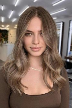 45+ Hair Colors For Brunettes | Ashy, Warm, Balayage, & More Dark Blonde Hair Color, Brown Blonde Hair, Hair Color Balayage, Hair Color For Black Hair, Hair Highlights, Lighter Brown Hair Color, Light Brunette Hair, Ashy Balayage, Balyage For Dark Hair