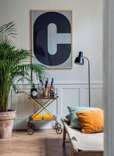 my scandinavian home: C print, bar cart and safari daybed in a delightful family home in Stockholm