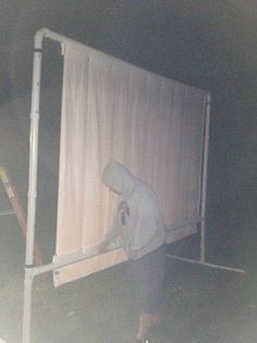 Outdoor Projector Screen on a Budget. I think it's better than my nailing a sheet to the side of the house. XD