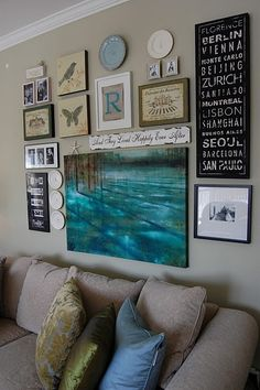 Gallery wall in the lovely living room of the blog:  A Pop of Pretty.http://apopofpretty.com/diy-monogram-wall-art/