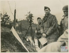 American Lt. General Mark Clark and Brazilian General Joao Batista de Mascarenhas survey enemy movements through telescopes. 30 November 1944.