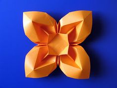 A neat four petal origami flower. No instructions, but there is a diagram.