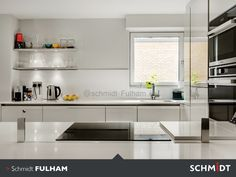 If you look carefully, you can make out the glass splashback in front of the hob.