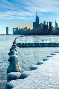ICY Chicago - One of those days in Chicago when Michigan Lake freezes. Icy look at Chicago skyline. Pinned by #CarltonInnMidway - www.carltoninnmidway.com