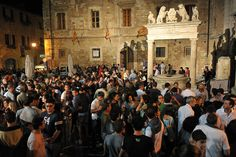 """Drinking Vino Nobile by night, at """"Calici di Stelle"""" event, every August 10 in Montepulciano."""