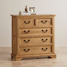 The attractive Edinburgh Solid Oak 3 + 2 Dresser has three full-width drawers nestled beneath two smaller drawers, and is made with resilient dovetail joints, solid oak drawer linings, and drop handles.