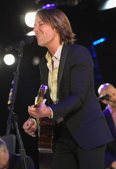 Keith Urban Photos - Keith Urban performs onstage at the BMI 2014 Country Awards at BMI on November 2014 in Nashville, Tennessee. - BMI 2014 Country Awards - Show Male Country Singers, Country Music, Keith Urban Guitar, Best Guitar Players, Awards, Pictures, Photos, Nashville Tennessee, Guitars