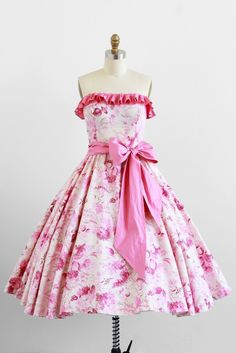 I want to hostess a summertime garden party and wear this dress. A  terrifically pretty pink and white ruffled summer party dress with a big  pink bow sash. 45a00f5aa2