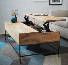 A pull-up coffee table can serve as a work space, eating space or play space and provides great functionality in a small family room