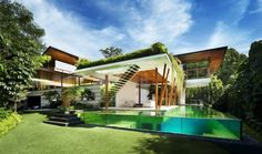 Built in Singapore, the Willow House is an open and airy home designed to invite as much of the outdoors inside. Created by Guz Architects