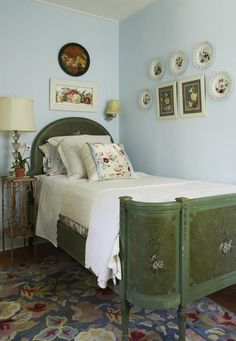I love to mix up sheets, notice how the bottom sheet and pillow case are floral, and the top sheet is lace edged. I made the European sham out of old linen napkins pieced together. And of course, no room is complete without plates on the wall.