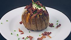 Bloomin' Potato  What You'll Need: 2 Baking Potatoes 1 cup cheddar, grated 1/4 cup crispy bacon ranch sauce, to serve chives, finely chopped oil salt