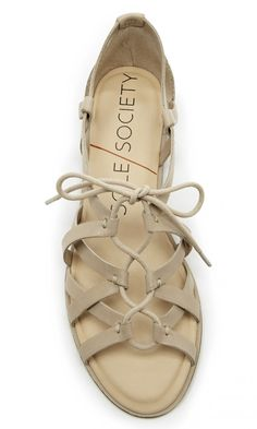 Gladiator-inspired, neutral leather lace-up sandal