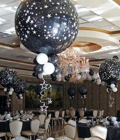 This balloon arrangement looks so cool! My niece's birthday is next month and putting these through out her part would add a fun touch. She loves space, so the black balloon with stars would be perfect for her.