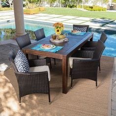 This clean and simple dining set combines the functionality of wood and iron with the comfort of wicker. Complete with a table and 6 wicker dining chairs, this set offers comfortable seating in the great outdoors. Sure to complement any patio decor, Outdoor Dining Set, Patio Dining, Outdoor Furniture Sets, Outdoor Decor, Outdoor Living, Outdoor Tables, Patio Bench, Backyard Furniture, Wood Patio