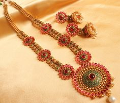 I found this beautiful design on Mirraw.com.. With d layer necklace