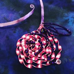A stunning handmade wire pendant necklace by #pictordesign  Truly a special piece, one of our fave from our new collection  View more at our online shop: www.pictor-spletnatrgovina.com  #handmade #jewelry #wiredesign #wirependant #rose #pink #purple #cutglass #jewelrydesign #handmadejewelry #pendant #necklace #wirenecklace #unique #handpainted #silk #handcrafted #art #craft #fashion #style #design #ljubljana #madeinslovenia #pictorshop