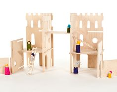 wood modular castle by manzanitakids, via Etsy. Maybe could make with balsa wood and popsicle sticks.
