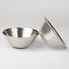 $60 Yanagi Bowl & Strainer Set - love the design and compact for my small home.   Good for straining herbal tinctures and vinegars - need to check on size of holes for that.